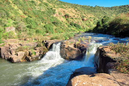 howick: Small waterfall on river. Shot in Umgeni Valley Nature Reserve, South Africa.