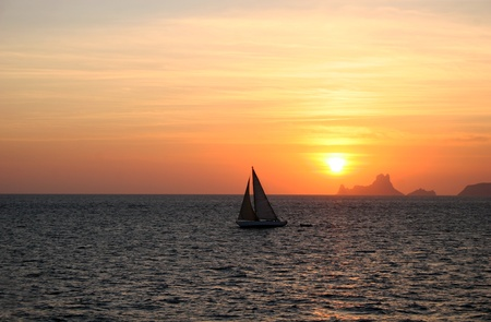 Yacht & Mediterranean Sunset in Ibiza, Spain photo