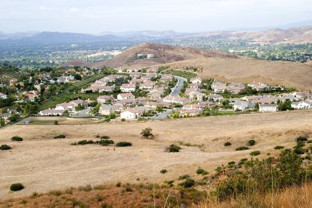 encroach: Communities of families spreading into the foothills of the countryside. Stock Photo