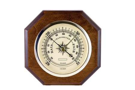 An instrument indicating the barometric pressure in inches. photo