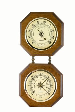 A hygrometer instrument showing the relative humidity in percents and a barometer instrument indicating the barometric pressure in inches. photo