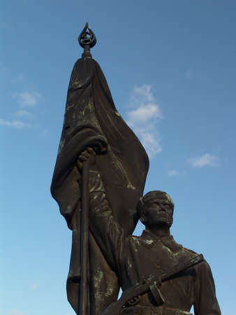 Russian soldier statue with flag