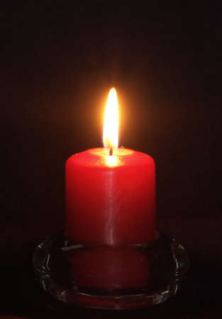red candle light on black background in a glass holder Stock Photo - 792885