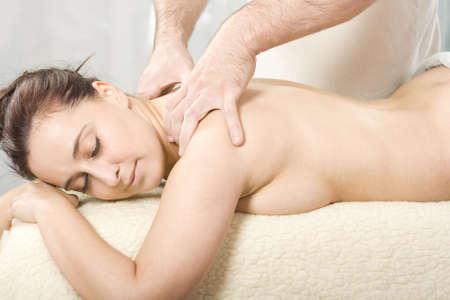 Relaxing nice lady having a massage treatement