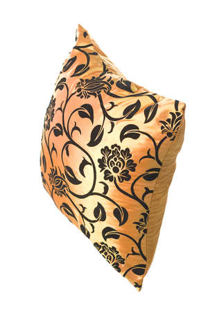 Golden silk pillow with black ornaments on white background for designers Stock Photo