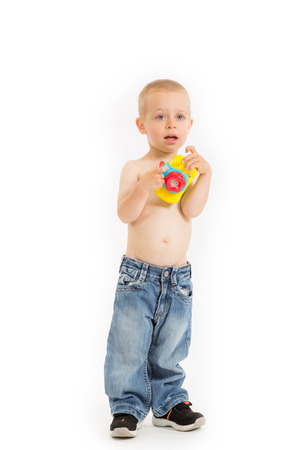 Young half naked boy is taking a photo with his toy camera