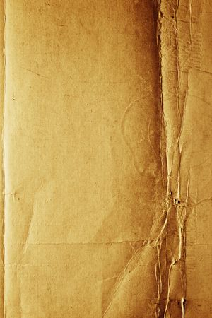 Yellow-brown messy rough old paper with cracks and folds