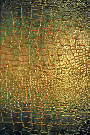 Green- golden bloody reptile leather texture Stock Photo