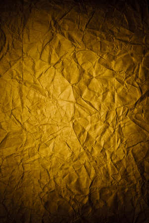 Dark vintage crumpled paper with dark borders. Image with vignette effect Stock Photo
