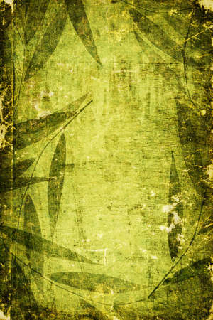 Green colored grunge artistic background with shabby texture and framed with floral pattern Stock Photo