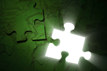 Conceptual image. Electronics solutions, green technologies, power saving, data protection concepts. Green illuminated puzzle with one piece lies above.