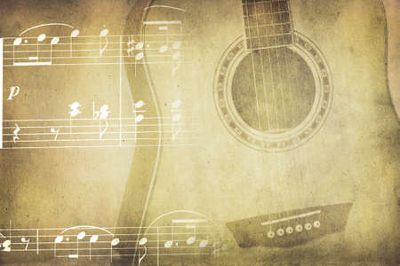 Vintage colors music background with wooden guitar and notes photo