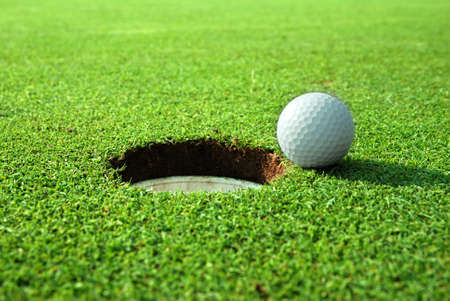 golf hole: Close to the goal!