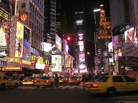 central square:  New York city, USA - December 24, 2004 -  Times Square with its yellow cabs by night  in New York on Christmas eve