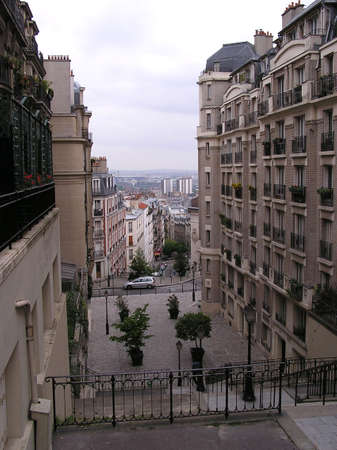 montmartre: PARIS - May 13: Montmartres famous stairs and luxurious apartments on each side. Paris, France that lead to Sacré-Cœur church in Paris, France. May 13, 2004