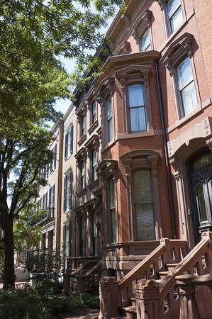 real estate house: WASHINGTON, DC - JUNE 24TH ; Row of elegant  red bricks houses  Washington, DC, 24th June 2007 Editorial