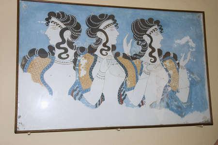 KNOSSOS, GREECE - MAY 12TH; Fresco of Minoen Palace representing three women profiles, Knossos, Greece,  12 May 2007