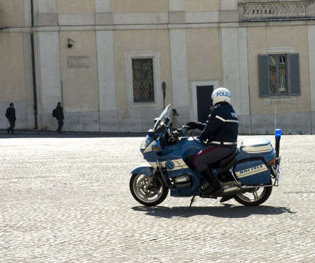 light duty: ROME, ITALY -MARCH 15:  Motorcycle policeman (polizia) on duty in Quirinale square, Rome, Italy, 15 March 2006