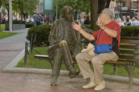Boston, Mass, USA - September 3rd, 2005;  Friendly conversation between seniors sit on a bench  in Boston Park, Mass. - humoristic picture