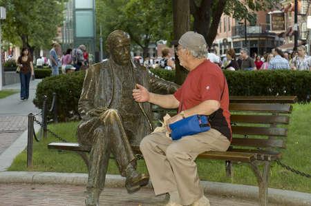humoristic: Boston, Mass, USA - September 3rd, 2005;  Friendly conversation between seniors in Boston Park, Mass.- - humoristic picture