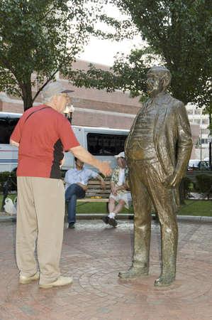 humoristic: Boston, Mass, USA - September 3rd, 2005;  Friendly shaking hand  of two seniors in Boston Park, Mass.- - humoristic picture