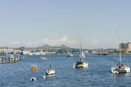 Boston, Mass. USA - September 4th, 2005;  Sailing  boats with solar panels and oil tankers on St Charles River, Boston, Mass Stock Photo - 9003934