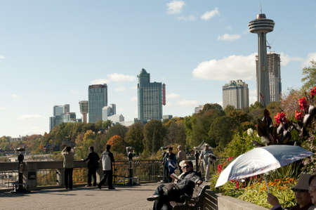 niagara falls city: Ontario, Canada - October 16th, 2008 : crowd along the path of Niagara Falls with view on the city on background,, the Skylon tower and the Casino, Ontario, Canada