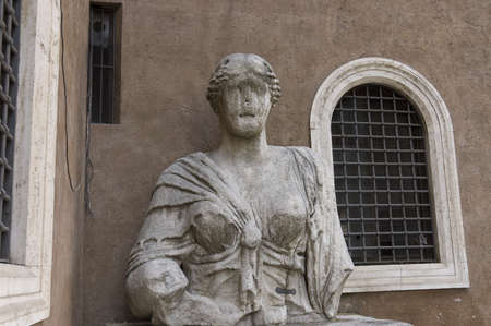 Rome, Italy - March 29th, 2006 : mutilated marble bust of a colossal statue of Madame Lucrezia also named the Talking statue, a priestess of Isis in Piazza di San Marco (square) Rome, Italy Stock Photo - 9777362