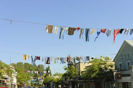 Columbia, California, USA - May 6th, 2006 : picturesque old timers clotheslines hanging in the middle of the street in the pionner town of Columbia for the annual Coutry Fair celebration, California, USA