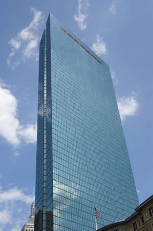 hancock building: Boston, Mass, USA - September 4th, 2005 : Blue Hancock Tower (241m790feet high),  merging into the blue sky with  clouds reflects on the glasses, Boston, Massachusetts