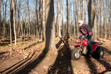 atv:  Quebec, Canada - November 23th, 2008 : men riding a four wheel ATV with speed in the woods of Quebec, Canada - motion picture Editorial