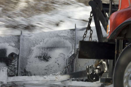 Quebec, Canada - December 6th, 2005 : close-up of snow plow truck on a Quebec rural road pushing the snow on the side action picture shallow DOF in purpose