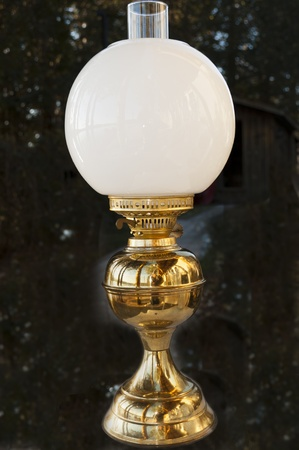 brass lamps: antique oil lamp with white lampshade isolated on a texture background