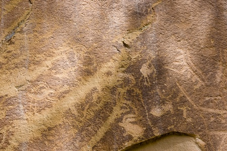 Utah, USA - April 29th, 2006 : Petroglyph or rock art carvings of Native Americans on a canyon wall in Freemont,  National Park Capitol Reef  Utah, USA