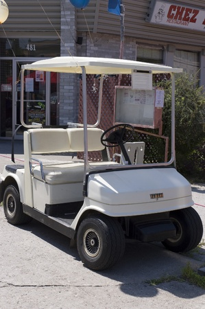 tradeshow: Mont-Laurier,Canada - July 13th, 2006 : Golf cart in display at a  tradeshow in main street of Mont-Laurier, Quebec, Canada Editorial