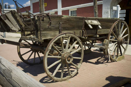 Montana, USA - May 16th, 2006 : Old horse wagon on display in street of rural country of Montana, USA