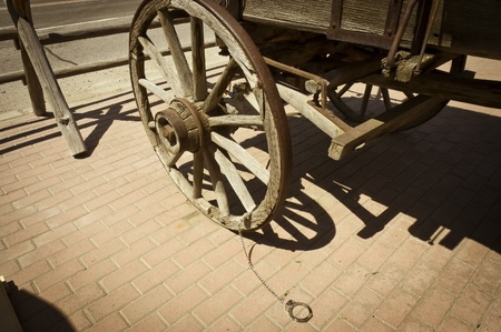 resisting arrest: Montana, USA - May 16th, 2006 :handcuff attached to a wagon wheel as used  in the old time, Montana, USA