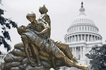 vietnam flag: Washington, DC - June 24th, 2007 :  Memorial statues to Vietnam war Women Nurse, Arlington, USA,with Capitol ghost picture behind Editorial