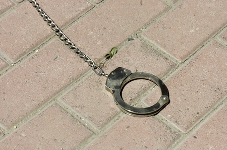 western usa: Frontier Town, Montana, USA -  May 16th, 2006 : handcuff on the sidewalk  used  in the western country , Frontier Town, Montana, USA