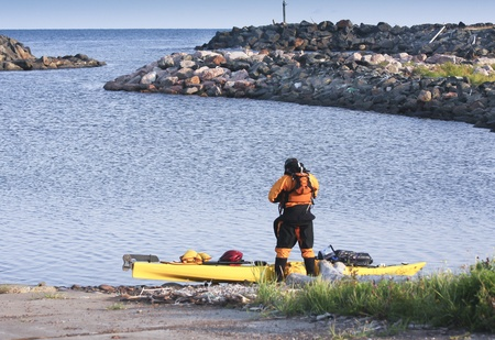 well equipped: kayak man surfer well equipped and ready for expedition on sea in Cape Breton, , Nova Scotia, Canada