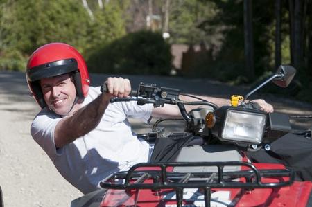 quad: young man riding a Quad