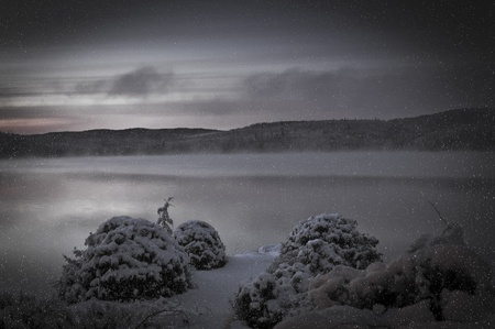 cold morning sunrise on a lake after a snowstorm, Quebec, Canada photo