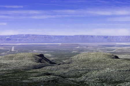 scenic view of a farmland beside  Guadalupe Mountains National Parks,  Texas, USA photo