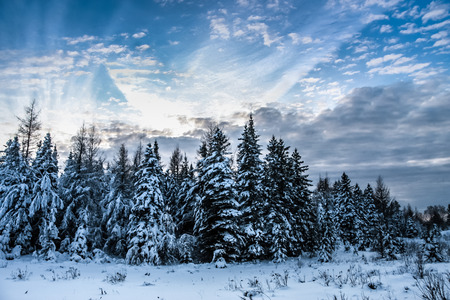 winter scene with beautiful cloudscape in rural country of Quebec, Canada photo