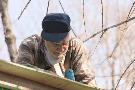 roof framing: senior in a ladder framing the roof an hunter shack