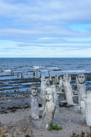 lawrence: The Great Gathering - stonework statues leading into the St. Lawrence River  in Sainte-Flavie, Gaspesia, Quebec, Canada.