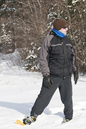 snowshoes: Mature man with snowshoes