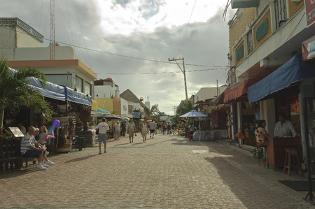 public market sign: Playa del Carmen, Mexico - December 12th 2006; Street scene after rain with tourists and merchants showing display and stores on coasts of Playa del Carmen, Mexico Editorial
