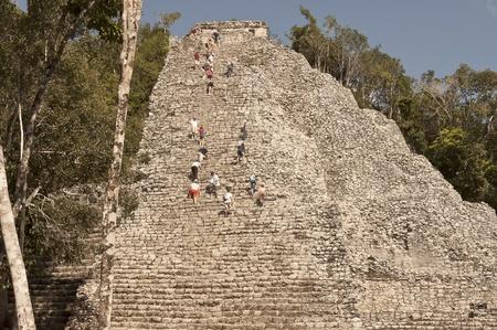 roo: Yucatan, Mexico - December 14th 2006: people climbing the Quintana Roo Coba Mayan Ruins , Yucatan, Mexico