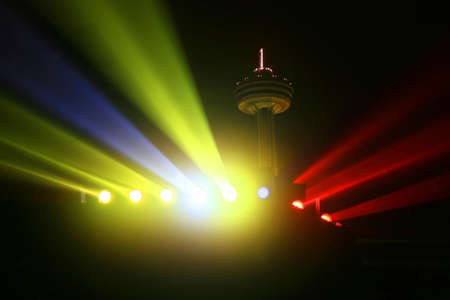 Niagara Falls Nightime Floodlights, backdropped by the Skylon Tower. Stock Photo